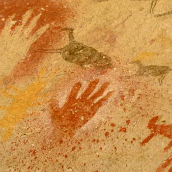 Native pictograph of handprints and deer